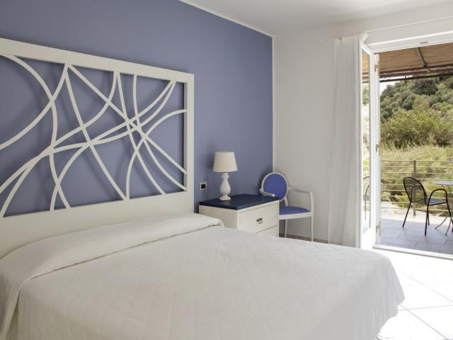 Camera Tripla Comfort vista giardino